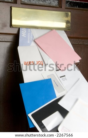 Stream of junk mail coming through the letter box, motion blur on mail. - stock photo