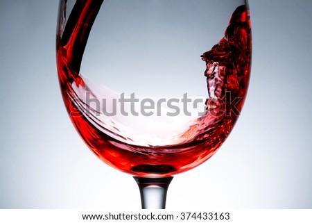 stream of wine being poured into a glass,  wine, splashing, splash,  - stock photo