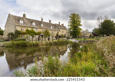 Stream running through the picturesque Cotswold village of Lower Slaughter, Gloucestershire, England - stock photo
