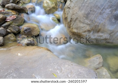 stream runs in  stone washed bed. Shooting from above. - stock photo
