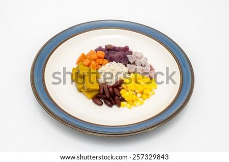 streamed vegetable on white background - stock photo