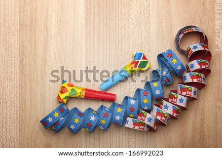 streamers and confetti as decoration for parties, sylvester with wooden background  - stock photo