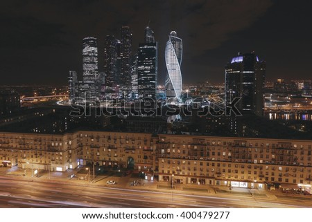 Street at night and modern skyscrapers Moscow, Russia, long exposure - stock photo