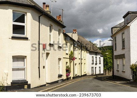 street bends at Moretonhampsted, Devon, view of bending street with old houses in the touristic village in the Dartmoor region  - stock photo