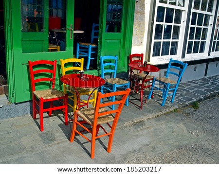 street cafe chairs tables colors - stock photo