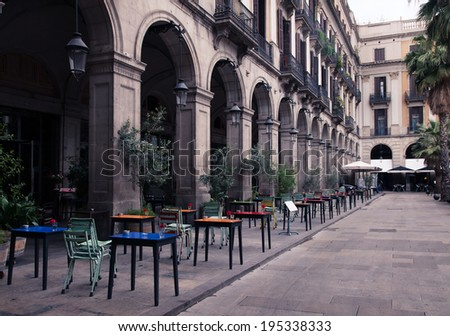 street cafe with colorful tables and chairs - stock photo