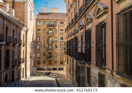Street Calle Pretil de los Consejos near the The Iglesia del Sacramento (Church of the Sacrament) in Madrid, Spain - stock photo