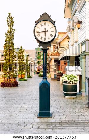 Street clock in the evening - stock photo