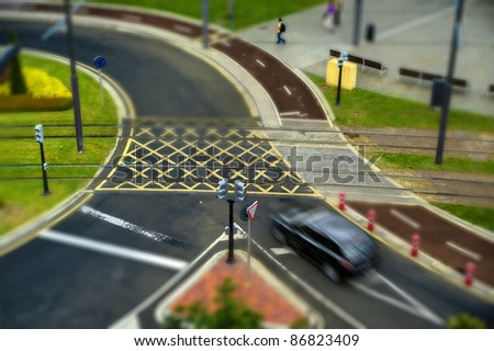 street crossing with tram and bicycle lane - stock photo