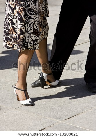 Street dancers performing tango dance. - stock photo