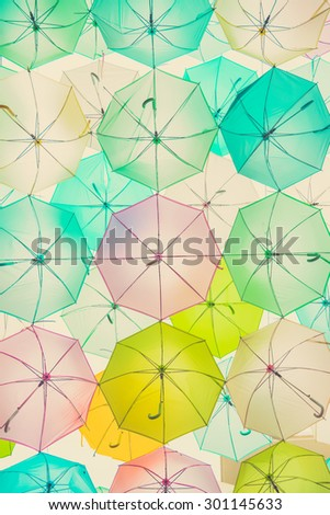 Street decorated with colorful umbrellas, Bangkok, Thailand. Vintage background. - stock photo