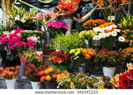 Street flower shop with colourful flowers - stock photo