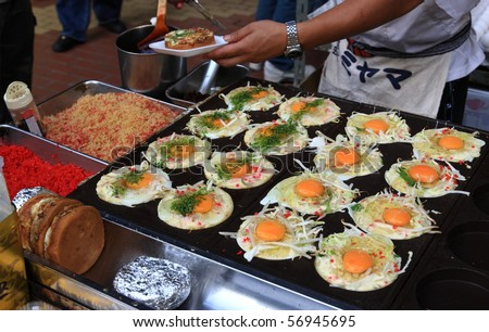 Street foo in Tokyo - eggs sunny side up asian style - stock photo