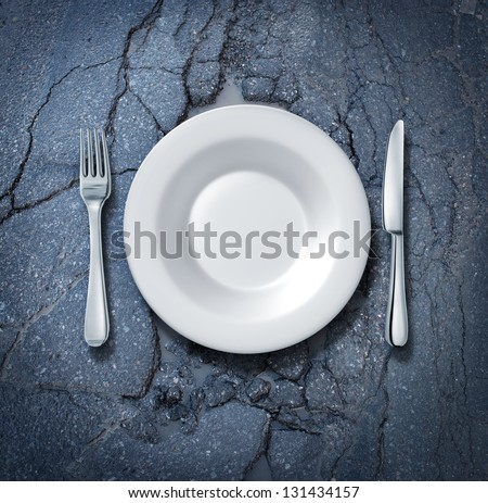 Street food and feeding the poor that are homeless and hungry with an empty white plate with fork and knife on an old dirty city asphalt road as a concept of unhealthy eating or urban cuisine. - stock photo