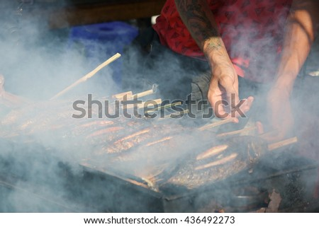 Street food - grilled fish  - stock photo