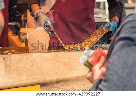 Street Food Vendor Grilling Asian Style Take Away Food. - stock photo