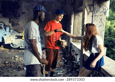 street guy greeting with his knuckles in a urban place - stock photo