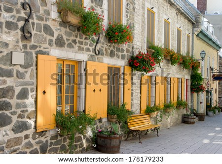 Street in a Staging Area with Bench, Flowerpot, typical of Old Quebec city. - stock photo