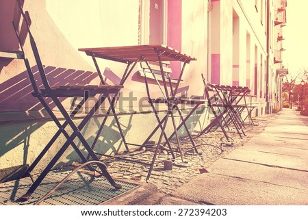 Street in Berlin in the Early Morning with still Closed Street Cafe - stock photo