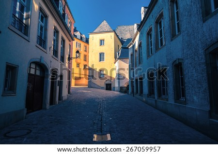 Street in Luxembourg. Sunset rays on an old building. - stock photo
