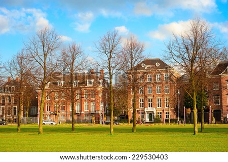 Street in Old Town of Amsterdam near museum place. Netherlands - stock photo