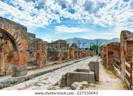 Street in Pompeii, Italy. Pompeii is an ancient Roman city died from the eruption of Mount Vesuvius in the 1st century. - stock photo