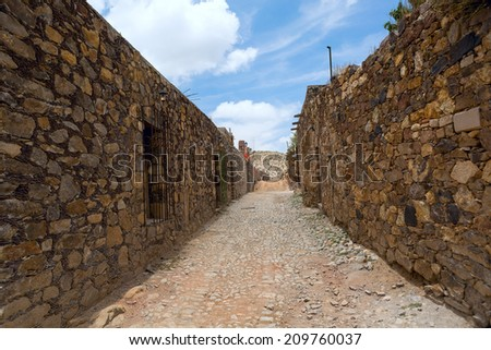 street in the abandoned silver mining town Real de Catorce - stock photo
