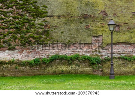 Street lamp against an old brick wall in Alba Iulia, Romania - stock photo
