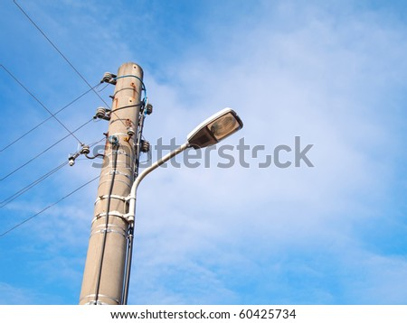 street-lamp on blue sky background - stock photo