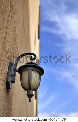 Street lamp on wall - stock photo