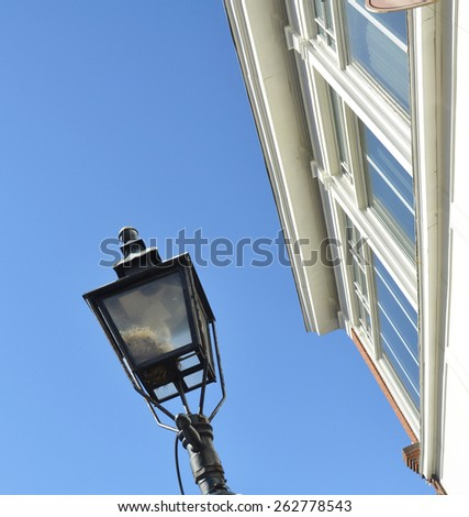 street lamp with the white building background - stock photo