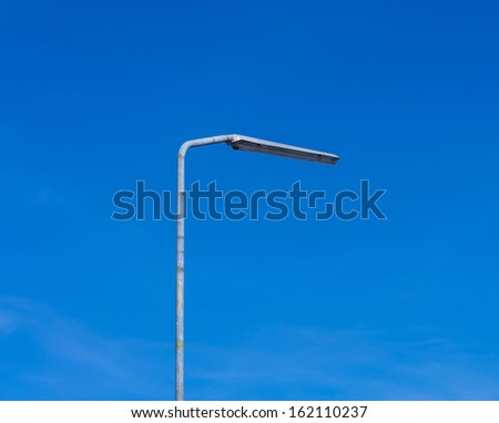 street lamppost on blue sky, electricity industry - stock photo