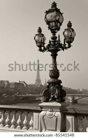 Street lantern on the Alexandre III Bridge against the Eiffel Tower in Paris, France. - stock photo