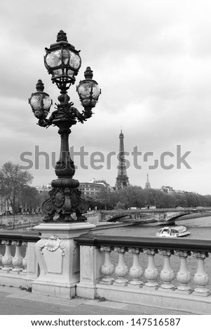 Street lantern on the Alexandre III Bridge with Eiffel Tower in Paris, France, monochrome pictire, - stock photo