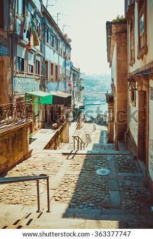 Street leading to the Douro river in Porto. - stock photo