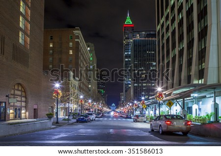 street level view of modern city of Raleigh, North Carolina at night - stock photo