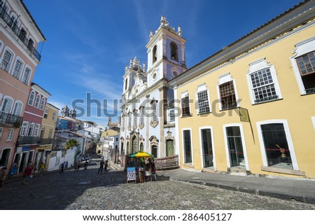 Street life on the cobblestones of the tourist center of Pelourinho in Salvador, Bahia, Brazil - stock photo