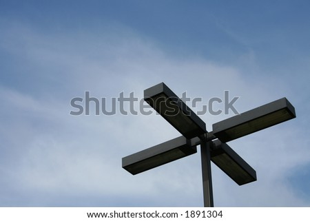 Street light against a blue sky - stock photo