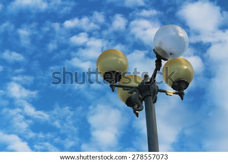 Street Light Against Blue Sky - stock photo