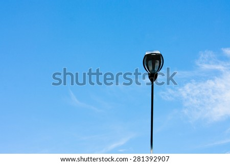 Street light against with a blue sky background - stock photo
