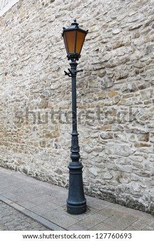 Street Light at Stone Wall Background - stock photo