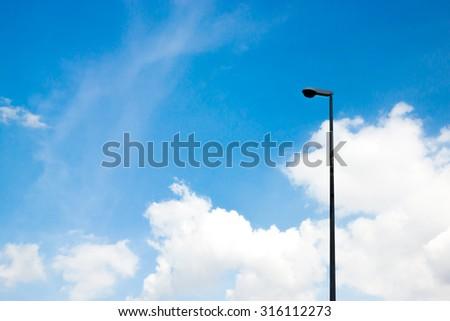Street light in the blue sky - stock photo