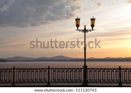 Street light on the promenade - stock photo