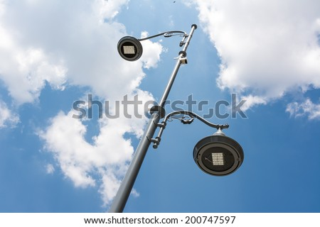 Street Light Pole Against Blue Sky - stock photo