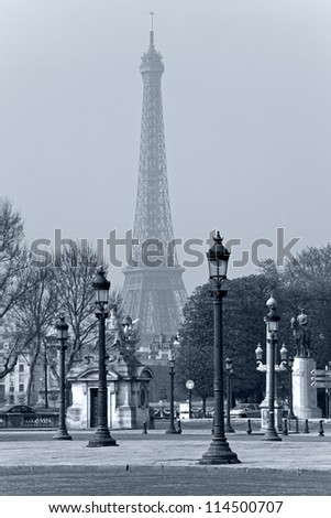 Street lights la Concorde, the Eiffel Tower in the background, in Paris, France. - stock photo