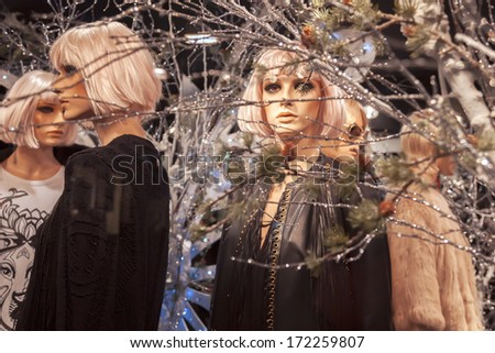 Street mannequin in shop window - stock photo