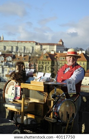 Street musician in Prague - stock photo
