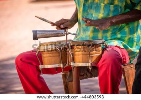 Street musician playing drums in Trinidad, Cuba - stock photo