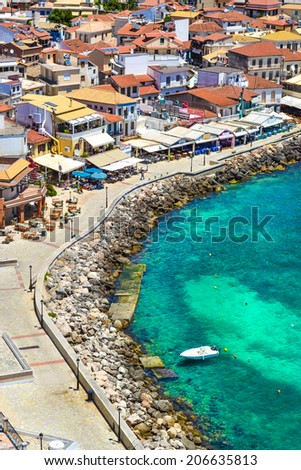 Street near the rocky coast in Parga, Greece. - stock photo