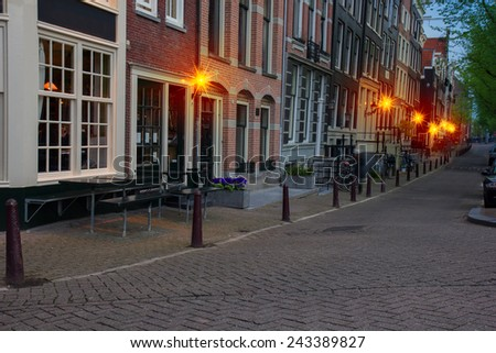 street of Amsterdam at dusk, the Netherlands - stock photo